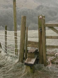 frosty landscape with stile in the foreground